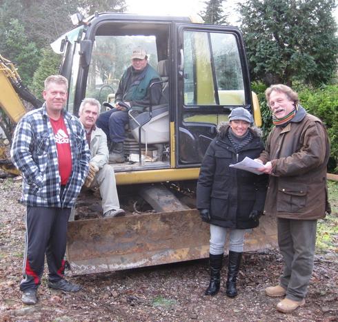 Herr Wiskirchen und sein Team mit der Bauherrin